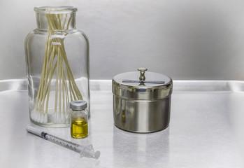 Syringe, vial, cotton swabsl