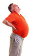 Overweight man with acute back ache bending over backwards to at