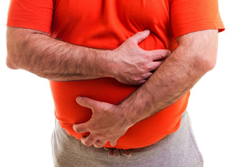 Man holds both hands on his aching stomach