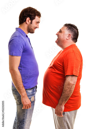 Two happy men standing face to face