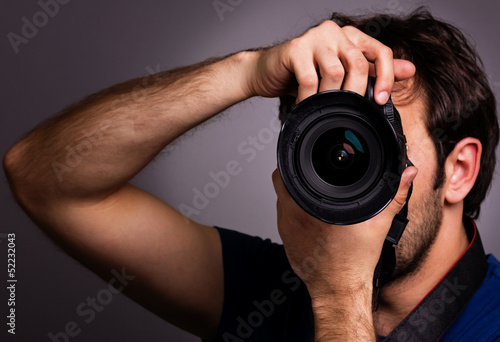Young man with professional camera