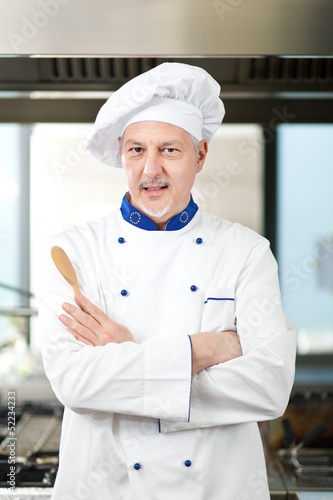 Male chef working in a restaurant kitchen