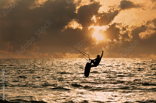 Kite surfer jumping from the water