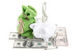 Piggy bank on the bills of American dollars isolated against whi