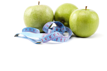 Fresh apples with measuring tape. isolated over white background