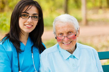 Portrait of Nurse and Elderly Patient