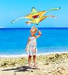 Kid flying kite outdoor.