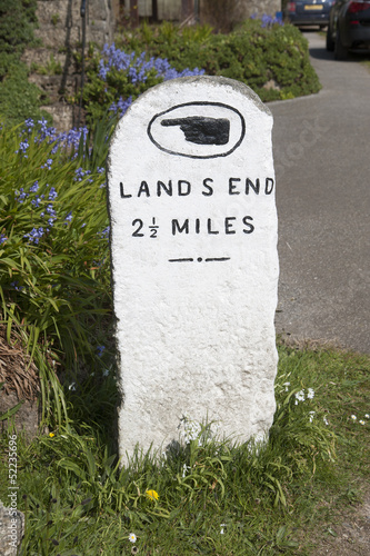 Milestone on roadside pointing to Land's End UK