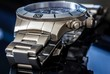 Luxury Watch over reflective surface, shallow depth of field