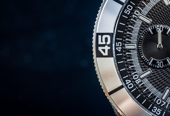 Steel watch detail, concept for time, selective focus