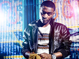 Black youth with jacket and colorful lights