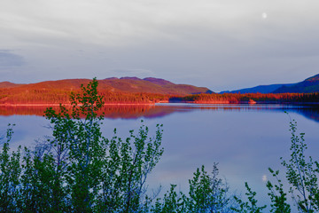 Evening sun glow on calm Twin Lakes Yukon Canada