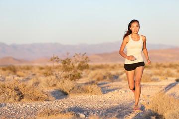 Woman runner running cross country trail run