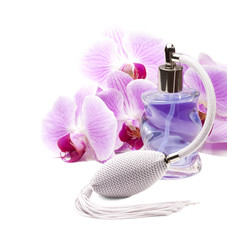 Perfume bottle, pink orchids on the white background.