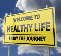 Road sign with words Welcome to healthy life