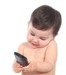 Beautiful baby playing and touching a smart phone