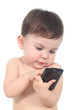 Beautiful baby playing and touching a mobile phone