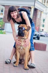 woman and dog bullmastiff