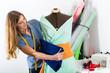 Fashion designer or tailor working in studio