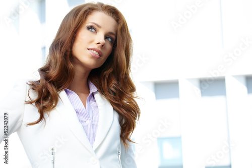 young brunette woman portrait in summer color