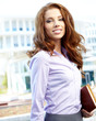 Attractive business women over modern street background