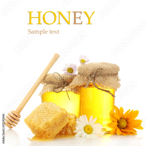 Jars of honey and honeycombs isolated on white