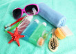 Hotel cosmetics kit on blue towel