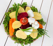 Many peeled vegetables  on wooden background