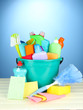 Cleaning items in bucket on  color background
