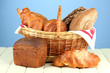 Composition with bread and rolls, in wicker basket