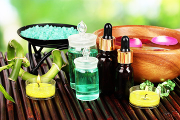 Spa composition with aroma oils on table on bright background