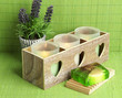 Candles in wooden candlestick, lavender and soap, on green mat