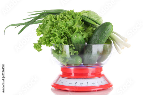 Fresh vegetables in scales isolated on white