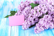 Beautiful lilac flowers on table close-up