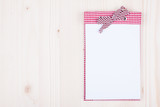 Notebook on white wood background