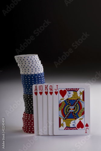 Poker hand with chips.