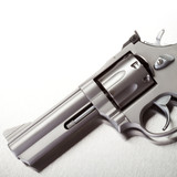Handgun on brushed metal