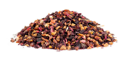 Macro of rose hip tea loose leaf granules in a pile on white