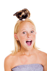 little kitten sitting on teen girl's head