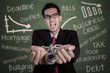 Angry businessman with hands chained at class