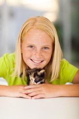 caring teen girl and pet kitten