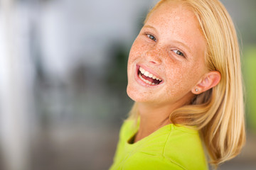 laughing preteen girl looking back