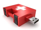 red medical kit concept computer help USB drive