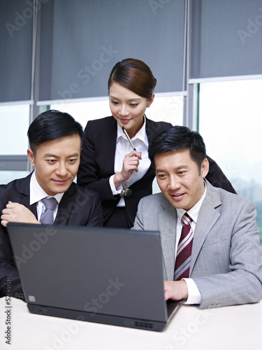 asian business team working together in office