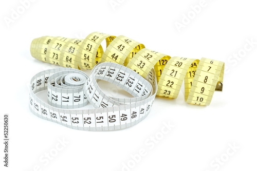 Yellow and white measuring tape isolated on white