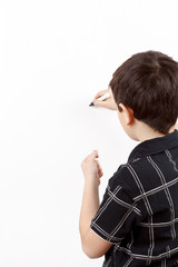 young boy student in a writing on a whiteboard