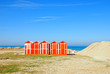 old wooden cabins on the sand near the sea in rimini, italy