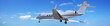 Private jet maneuvering in a blue sky. Panoramic composition.