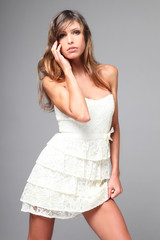 Sensual girl with elegant white dress