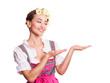 attraktive junge Frau im Dirndl mit Offener-Hand-Geste